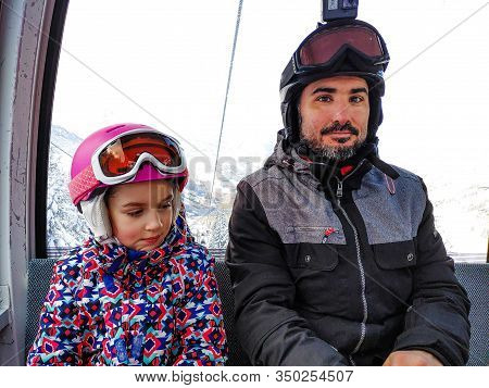 Family Riding Cabin Cable Car On Winter Vacation Skiing. Family On Winter Vacations Ski Trip Taking