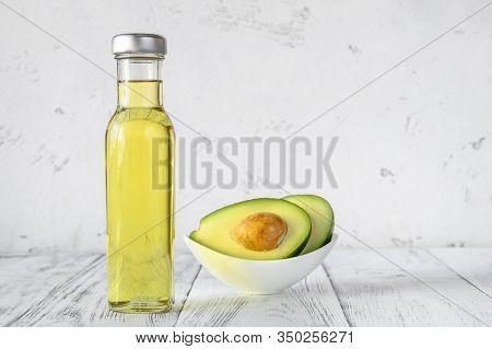 Bottle Of Avocado Oil With Fresh Avocado: Top View