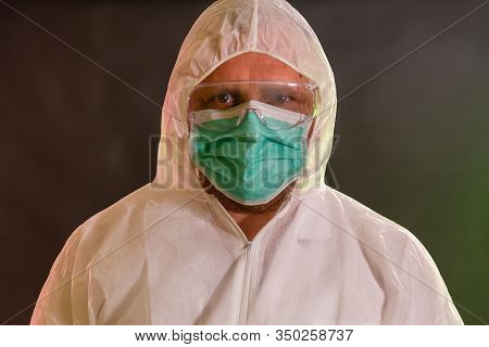 Man In Chemical Suit Looking At Camera