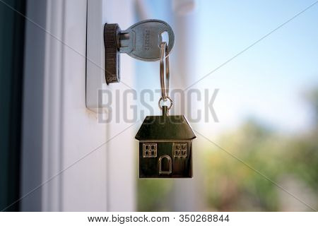 The House Key For Unlocking A New House Is Plugged Into The Door.
