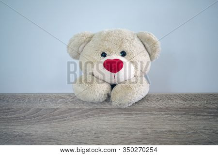 Background For Kids Play Teddy Bear. Brown Hair Teddy Bear Standing Behind The Wood. Children's Play