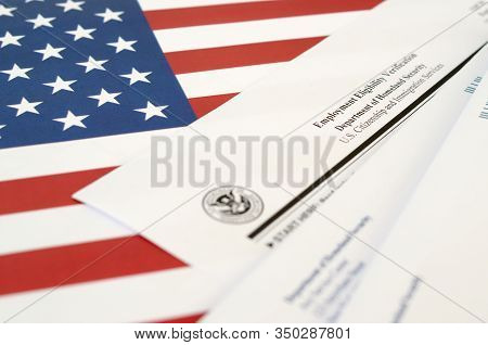 I-9 Employment Eligibility Verification Blank Form Lies On United States Flag With Envelope From Dep