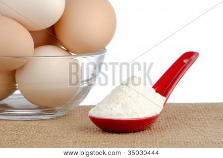 Brown Eggs On Brown And Red Ceramic Spoon With White Powder