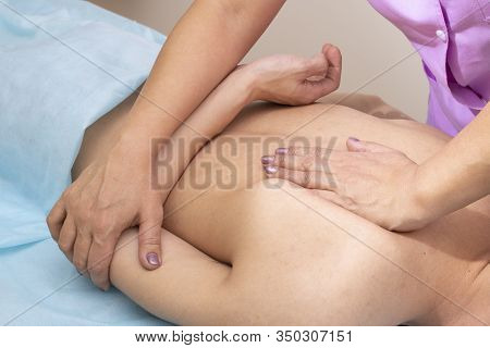 Man Having Chiropractic Back Adjustment. Osteopathy, Alternative Medicine, Pain Relief Concept. Phys