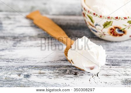 Fresh Homemade Mascarpone. Traditional Mascarpone Cheese In Wooden Spoon