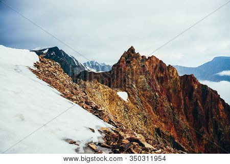 Beautiful Pointed Rocky Pinnacle On Giant Snowy Mountain. Vivid Big Pointy Rocky Peak. Atmospheric M