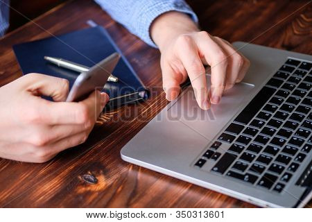 The Man Performs The Work Remotely. The Concept Of A Freelancer And A Hired Worker. Close Up.