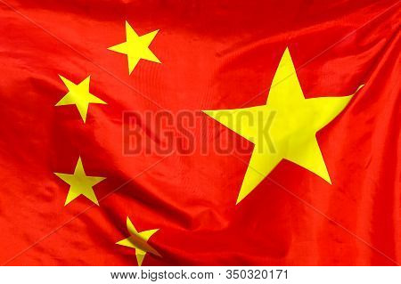 Fabric Texture Flag Of China. Flag Of China Waving In The Wind. China Flag Is Depicted On A Sports C