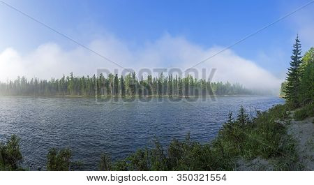Panorama Of The Shore Of A Mountain River. Mountains Are Hidden By Rising Morning Fog. The Oka Sayan