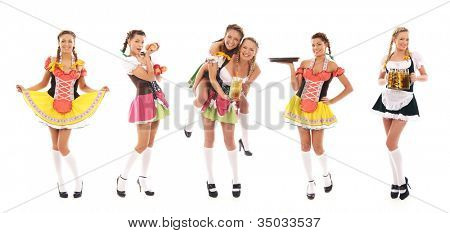 Young and beautiful bavarian girls isolated over white background