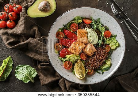 Healthy Salad With Fillet Salmon, Quinoa, Avocado Sauce, Grilled Pepper, Tomatoes, Lettuce, Arugula