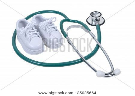 Stethoscope And Small White Shoes