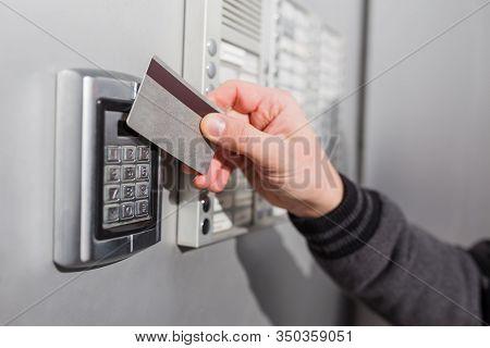 Door Access Control. Man Hand Holding Key Card To Lock Or Unlock Door.