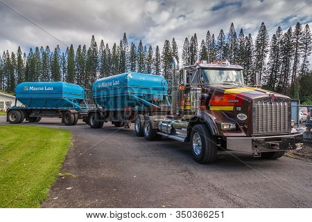 Hilo, Hawaii, Usa. - January 9, 2012: Heavy Red-brown Truck With 2 Blue Trailers Loaded With Freshly