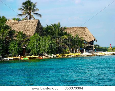 Thatched Roof Huts On The Beach