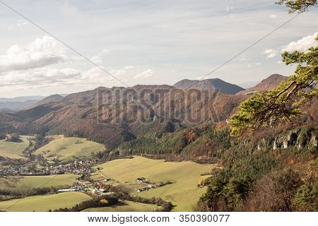 Sulov-hradna Village With Partly Rocky Hills Of Sulovske Vrchy Mountains Covered By Colorful Forest