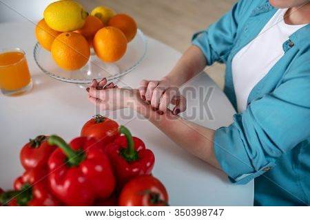 Woman Itching Her Hand Because She Is Alergic To Products