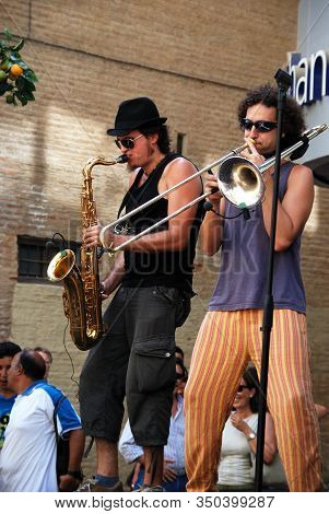 Malaga, Spain - August 18, 2008 - Saxophonist And Trombone Player Performing At The Feria De Malaga,