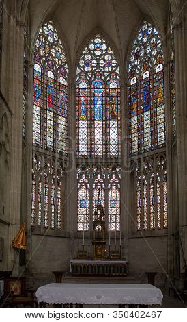 Troyes, France - August 31, 2018: Colorful Stained Glass Windows And Altar In  Basilique Saint-urbai