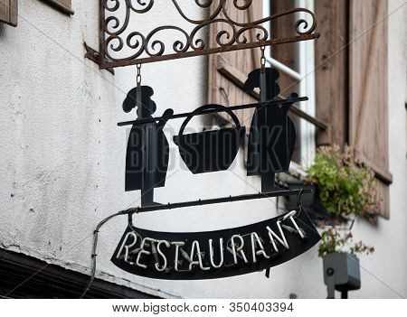 Troyes, France - August 31, 2018: Artistically Stylized Advertising Of Restaurant In Medieval Troyes