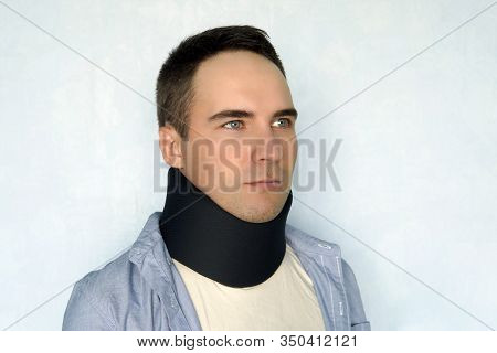 Medical Cervical Collar. A Sick Man With A Black Collar To Fix A Neck Fracture.