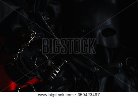 Set Of Accessories For Bdsm Sex With Domination And Submission. Leather Whip Flogger, Handcuffs And