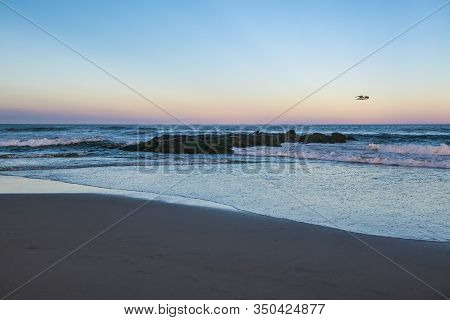 A Peaceful Beach Scene At Dusk In Spring Lake Along The Jersey Shore.