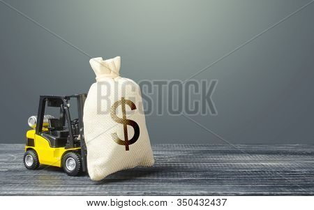 Yellow Forklift Carries A Dollar Money Bag. Tax Payment. Payment Of Taxes. Big Contract, Profitable