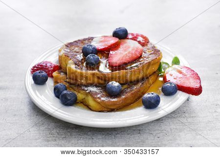 Delicious French Toast With Fresh Fruits And Maple Sirup. Tasty Breakfast Scene Or Dessert With Toas