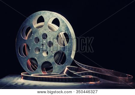 Movie Reel Film On A Wooden Background