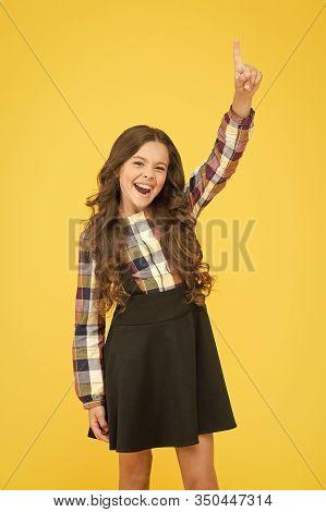 A New Genius. Happy Schoolgirl Got Genius Idea. Genius Little Child Pointing Finger Up. Wonder Kid O