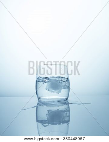 A Glass With Clean Fresh Purified Water With An Ice Cube. Cool Refreshing Drink Quenching Thirst, A