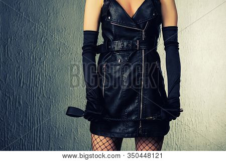 The Dominant Woman In A Leather Dress With A Spank In Her Hand. Bdsm Outfit- Image Toned