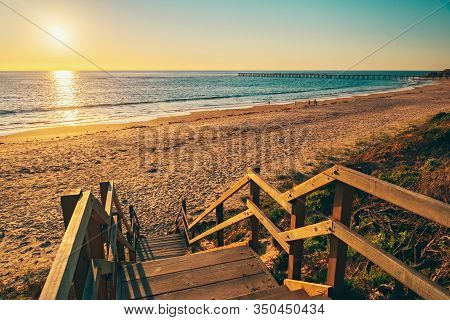 Port Noarlunga Beach With Boardwalk At Sunset, South Australia
