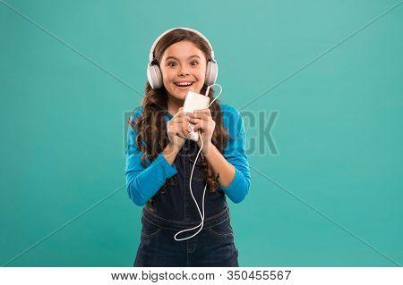 She Is So Happy. Happy Little Girl. Schoolgirl Use Digital Device. Casual Fashion For Kids. Kid Long