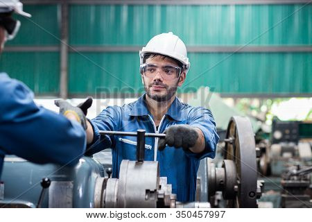 Turner Is Working On The Machine.metal Processing.worker Works On A Lathe.turner Running On The Mach