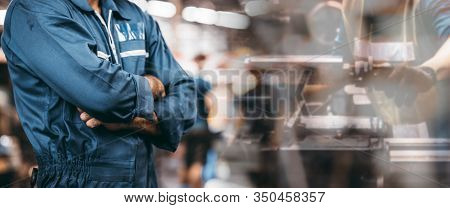 The Image Engineer Men Working In A Manufacturing Plant For Background Of Industry. Men Is Standing