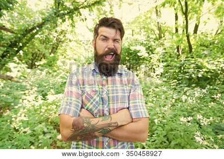 Tipping A Wink. Caucasian Man On Summer Landscape. Bearded Man With Unshaven Beard Hair On Caucasian