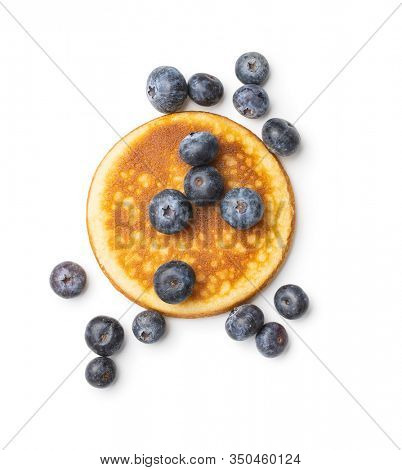 Sweet homemade pancakes and blueberries isolated on white background.