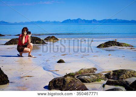 Woman Take Photo On Beach, Lofoten Norway