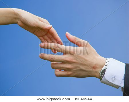 Handshaking With Blue Sky Background