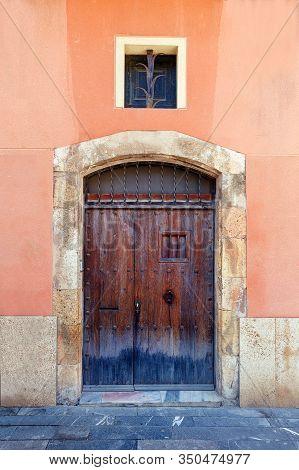 Old Vintage Wood Door In Concrete Wall.
