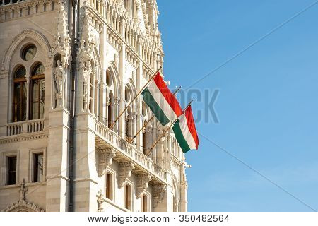 Hungarian Flags On The Hungarian Parliament Building Or Parliament Of Budapest, A Landmark And Popul