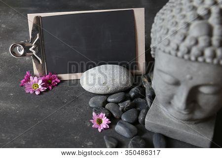 Buddha Head With Stones , Flowers And Tabular