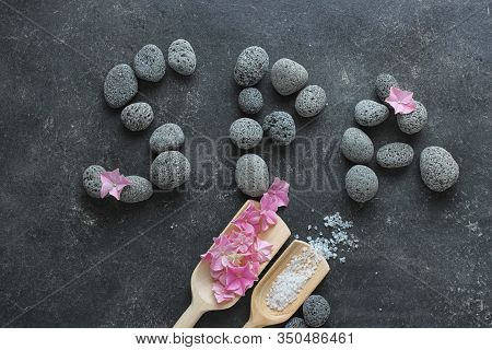 Dark Spa Background With Pebbles And Flowers