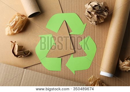 Recycle Sign On Craft Background With Craft Paper, Top View