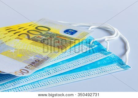 Medical Masks And 200 Euro Bills As A Symbol Of Increased Prices For Protecting The Respiratory Trac