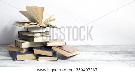 Open Book, Hardback Books On Wooden Table. Back To School. Copy Space