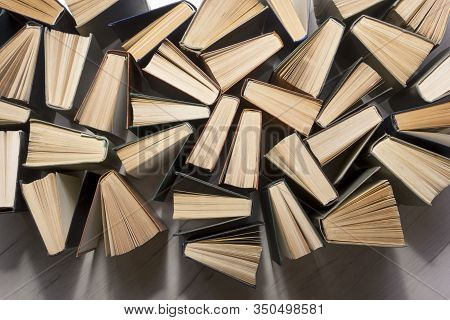 Stack Of Books Background. Many Books Piles.
