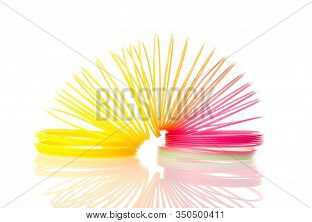 Rainbow Colored Wire Spiral Toy On White Background